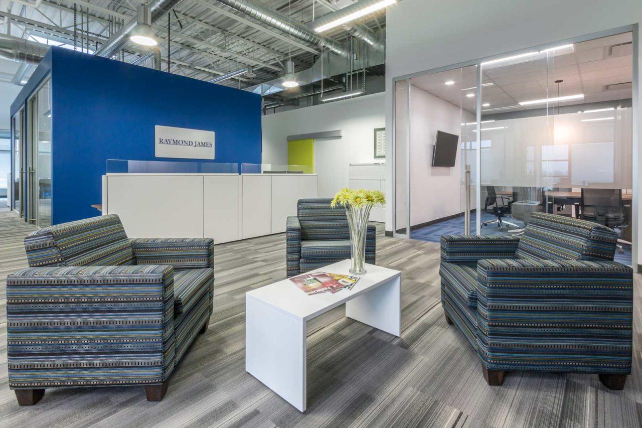 Raymond James Branding Wall & Lounge | Mayhew | Corporate Interior Design